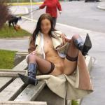 carelessinpublic: Almost nude in a park and showing her pussy