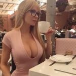 Very hot busty blonde with nerdy glasses drinking coffee