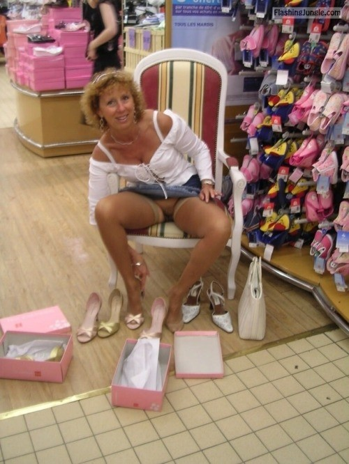 Pantyless cougar at the shoe store upskirt pussy flash public flashing no panties milf pics mature flashing store