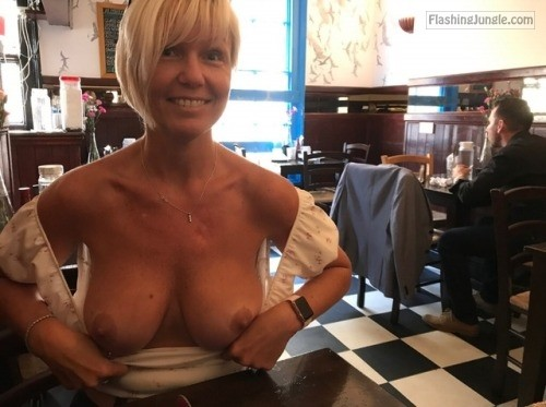Short haired blonde Cougar restaurant public flashing milf pics howife boobs flash