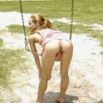 Skinny redhead bent over in park