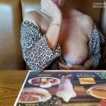 Woman big boob out in restaurant