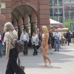 Leipzig Germany: Naked blonde walking down pedestrian zone