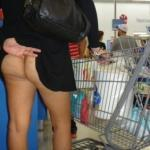 Pantyless shopping: hotwife pulls up black dress