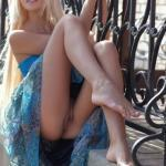 Barefoot pantyless teen blonde in blue dress