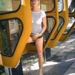 Pantieless in telephone booth