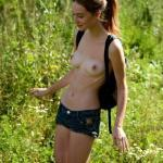 Topless hoe wears denim shorts nature