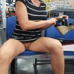 Short haired cougar pantyless at shoes store