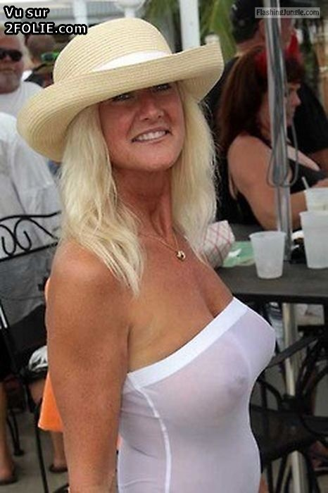 Voyeur Pics Public Flashing Pics MILF Flashing Pics Boobs Flash Pics Bitch Flashing Pics - MILF in white hat: big round tits see through white blouse