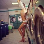 Undressing herself in public laundry