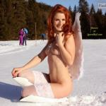 Fiery redhead angel naked in snow