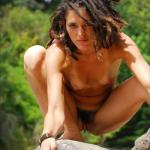 Exotic jungle girl caught naked on rock