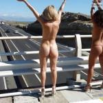 Blonde and brunette in high heels highway flashing