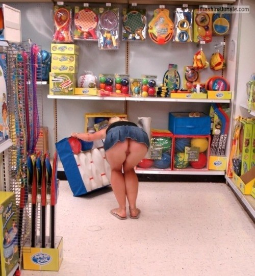 Pantyless in toy shop: Blonde in denim skirt bent over upskirt public flashing no panties ass flash
