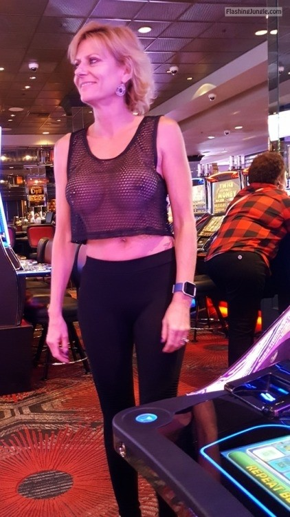 See through tank top: Strolling through the Casino. public flashing milf pics mature boobs flash bitch