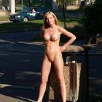 European blonde naked next to street trash can