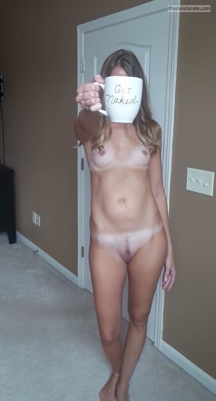 Naked hotwife holding a Got naked cup in hotel public nudity howife