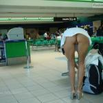 Bottomless in heels and mini dress bent over on airport
