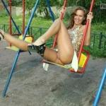 Having fun pantyless on swing