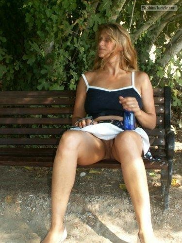 Married cougar doesnt wear panties on vacation voyeur upskirt pussy flash public flashing no panties milf pics