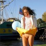 Yellow skirt up pantieless – windy day on riverband