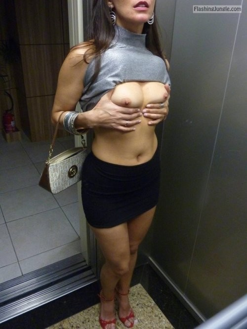 All dolled up babe cute titties and nipples in elevator boobs flash