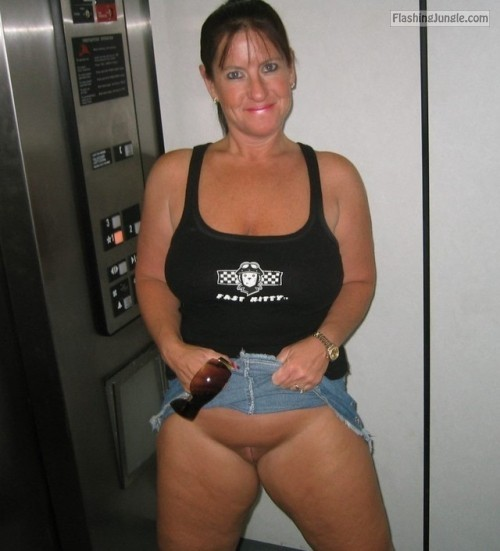 Chubby wife in elevator upskirt pussy flash no panties milf pics