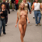 Cute blonde curly hair naked on crowded street smiling