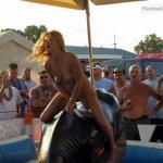 Naked MILF blonde riding bull