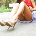 Sitting on asphalt pantyless Just to show new high heels