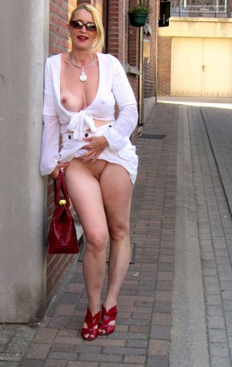 Skimpy slutty blonde milf: red heels and bag, flashing with style upskirt pussy flash public flashing no panties milf pics howife boobs flash