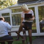 Naughty blonde teacher pantyless black stockings outdoor
