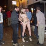 German Blonde on leash in chains surrounded by drunk guys
