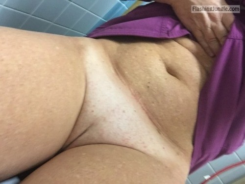 Bottomless MILF shaved cunt in public toilet pussy flash no panties milf pics