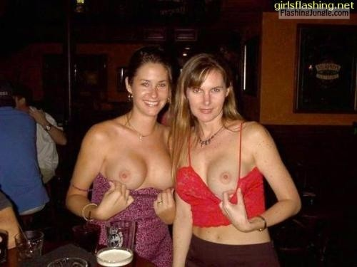 Drunk wife showing tits at bar