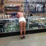 carelessinpublic:Almost topless inside a shop in a short skirt…