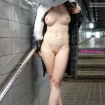 miaexhib:Naked under my coat in the subway station