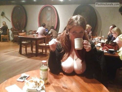 Busty brunette busts out the good in the middle of the... public flashing