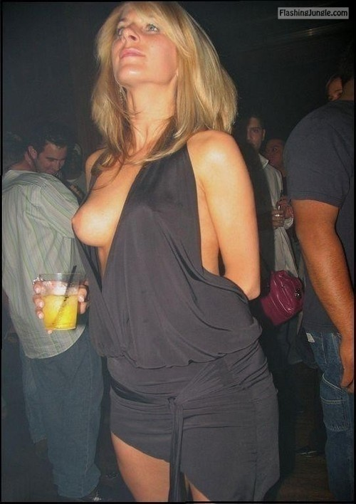 carelessinpublic:Drunk and showing her boobs in a party public flashing