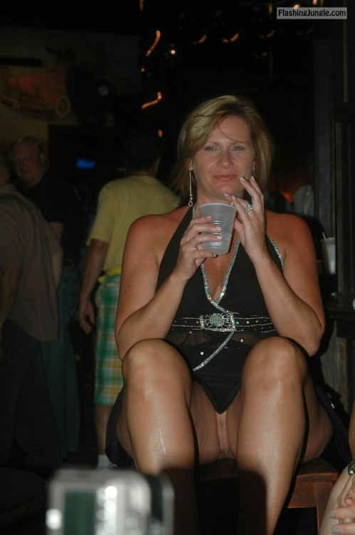 carelessinpublic:Milf in a short dress inside a bar and showing... public flashing