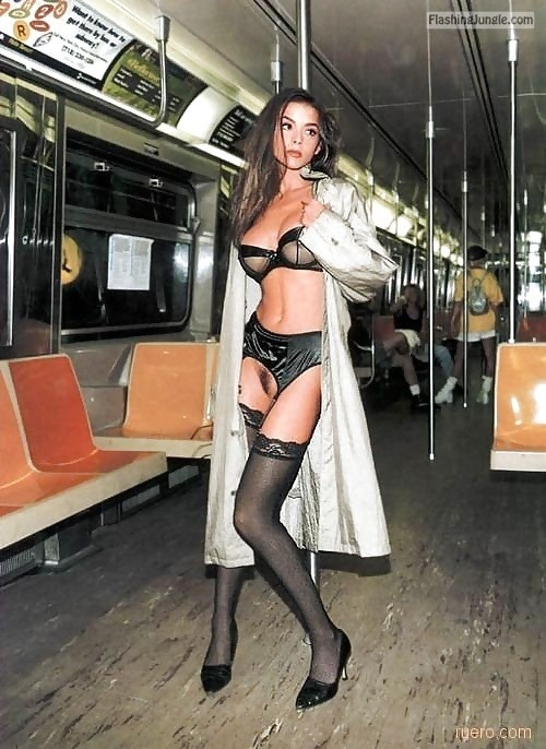carelessinpublic:Inside a train in a trenchcoat and showing her... public flashing