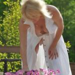 Voyeur shot – neighbor's wife in garden no underwear