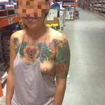 Tattooed girl cute boob flash at store