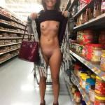 Wild brunette flashing her goodies at the store