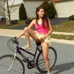Dirty teen in short skirt flaunts her muff on the bicycle