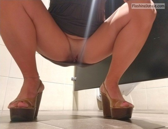 Wild Asian girl squats in the public toilet and flaunts her coochie upskirt no panties bitch
