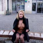 Blonde bimbo in sexy stockings and coat