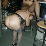 Mature swinging wives pleasing each other at the bar