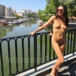 Brunette with perky tits naked in public