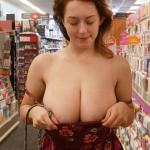 Attractive ginger gets her massive juggs out at the store